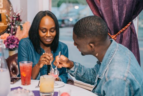 A young couple enjoy sharing a dish at The Purple Poulet