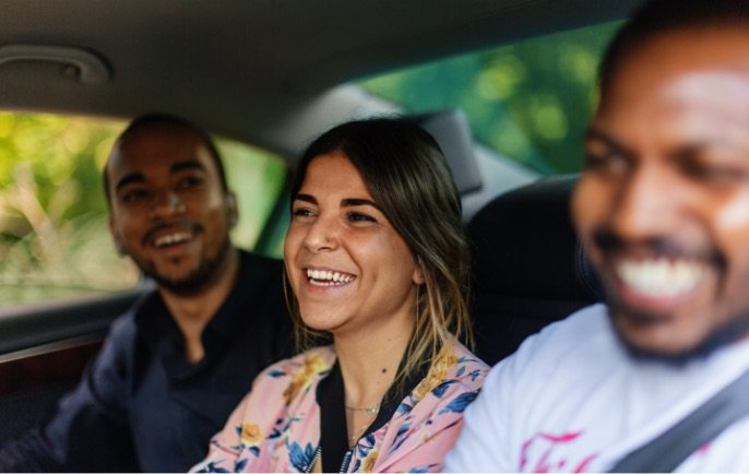 People laughing in car.
